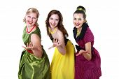 stock photo of poodle skirt  - three stylish young woman in bright colour dresses - JPG