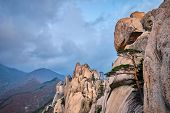 View of stone and rock formations from Ulsanbawi rock peak in stormy weather. Seoraksan National Par poster