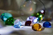 Defocused  Overturned Glass With Gems