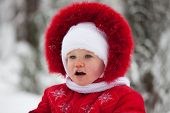Little Girl In A Red Winter Suit