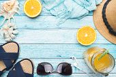 Blue Sandals, Hat And Orange Juice On Blue Background With Copy Space. Concept Summer Vacation. Flat poster
