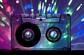 pic of magnetic tape  - Transparent Cassette tape and blue pink color disco light background - JPG