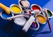 Cans And Paint And Brushes On The Blue Background