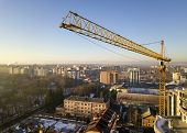 Apartment Or Office Tall Building Under Construction, Top View. Tower Crane On Bright Blue Sky Copy  poster