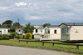 stock photo of trailer park  - Scenic view of caravan trailer park with road in foreground - JPG