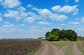 two rural road and cloudy sky