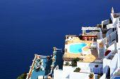 A luxury swimming pool situated in the town of imerovigli on the greek island of santorini