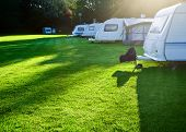 stock photo of caravan  - Campsite with caravans in a morning light - JPG