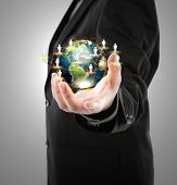 Business man holding the small world in his hands against white background (Elements of this image f