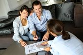 pic of family planning  - Couple signing financial terms for future property - JPG