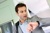 stock photo of leaving  - Businessman running late for work - JPG