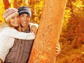 Picture of happy people spending fun time together in beautiful autumn park, closeup portrait of att