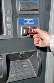 Woman insert card to withdraw money
