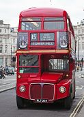 LONDON - FEBRUARY 13: Red Double Decker Bus on the Trafalgar square in London on Febuary 13, 2010 in London, UK. These dobledecker bus is one of the most iconic symbol of London.