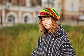Young rastafarian woman on a city street