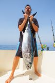 stock photo of troll  - big Bluefin tuna catch by fisherman on boat trolling posing on deck - JPG