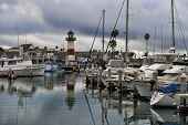 OCEANSIDE, CALIFORNIA - OCTOBER 21: Lighthouse and boats in calm waters as a storm passes through So
