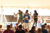 TULSA, OK - OCT 20: Party goers drink beer and sing songs at Oktoberfest in TULSA, OK, on October 20
