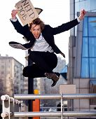 Jumping Businessman With Sign Need Job Outdoors
