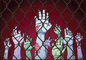 Creepy zombie hands behind a fence. Fence, hands and background on separate layers for easy editing.