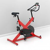Red spinning bike at home in the training room