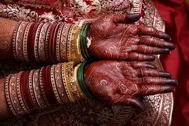 stock photo of dulhan  - hands of an indian bride showing her wedding mehendi - JPG