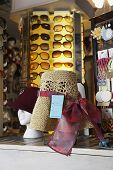 Closeup of hats and sunglasses on display at second hand store