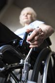 foto of physically handicapped  - Low angle view of a blurred senior woman operating wheelchair - JPG