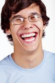 picture of laugh out loud  - Close up portrait of laughing young man in glasses and blue shirt over white background - JPG