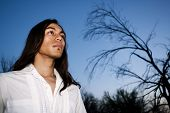 picture of native american ethnicity  - Handsome young man with long hair in an outdoor setting - JPG
