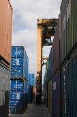 View of stacked containers and crane in stockyard at Limassol Cyprus