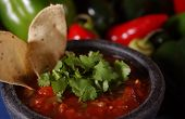 picture of cilantro  - Fresh salsa in a bowl topped with cilantro and a couple of tortilla chips - JPG