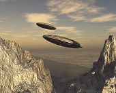 Flying saucers over mountains