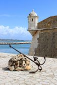 stock photo of bandeiras  - 17 century fortress with an anchor on the seafront of Lagos Algarve Portugal called Forte Ponta da Bandeira - JPG