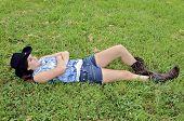 Teenage Girl Lying In Grass