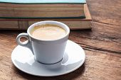 Espresso And Books On Table