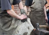 image of anvil  - Hammer anvil and hands of working men blacksmiths - JPG