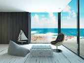 Lounge chair against huge window with seascape view
