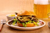 Ochsen Semmel - Grilled Beef With Onion Rings In Bun