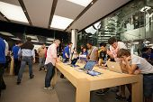 HONG KONG, CHINA - NOVEMBER 11, 2012: Buyers and shop assistants at Apple store in Hong Kong. Store
