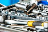 stock photo of garage  - Assortment kit of adjustable metallic tools in mechanic garage car service - JPG
