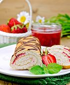 Roulade With Strawberries And Daisies On A Board