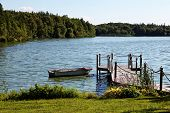 stock photo of dock a pond  - Pond with Boat Dock on Sunny Day - JPG