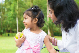 stock photo of indian apple  - Happy Indian family - JPG