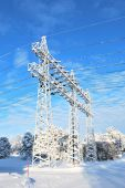 picture of power lines  - Electricity pylons and transmission lines covered with rime in winter - JPG