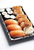Sushi food on tray against white background