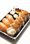 Sushi food on tray with German flag against white background