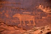 stock photo of potash  - Fremont Indian petroglyphs depicting a hunting scene with a bear Potash Road scenic byway  - JPG