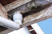 image of gutter  - closeup of flaking asbestos guttering in need of maintenance