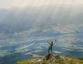 Extreme Runner Finally Climbs The Mountain Top And See Wide Valley